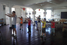Volunteer teachers teaching Taichi to the children from Chinese Association 3