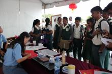 Volunteer Yan Jing performs paper cutting 1