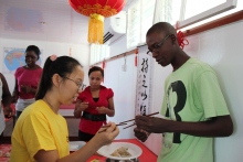 Learning to use Chinese chopsticks 1
